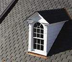 gray composite slate roof with a white dormer window