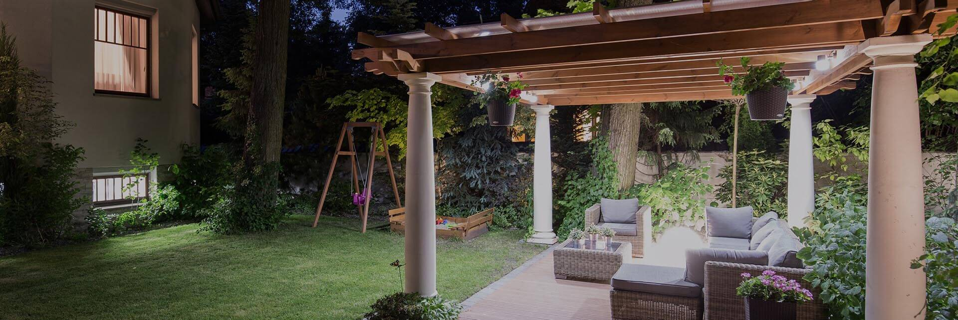 photo of lighted patio pergola in a back yard