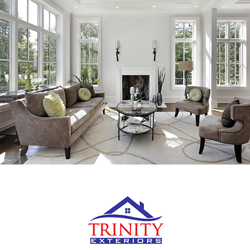 formal white living room with large multi-pane windows on every wall, with trinity exteriors logo