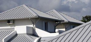 gray r-panel roofs on a white building