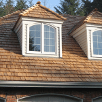 wood shake roof with white dormer windows