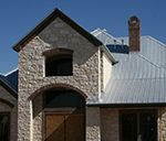 gray metal roof on a stone house