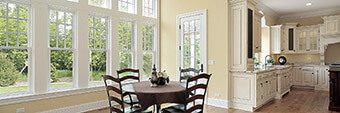 photo of a wall of windows in a dining area of a home